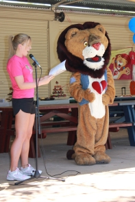 Patch's friend Erin laughs with the lion as they entertain the kids at the HeartKids WA Awareness Month Picnic